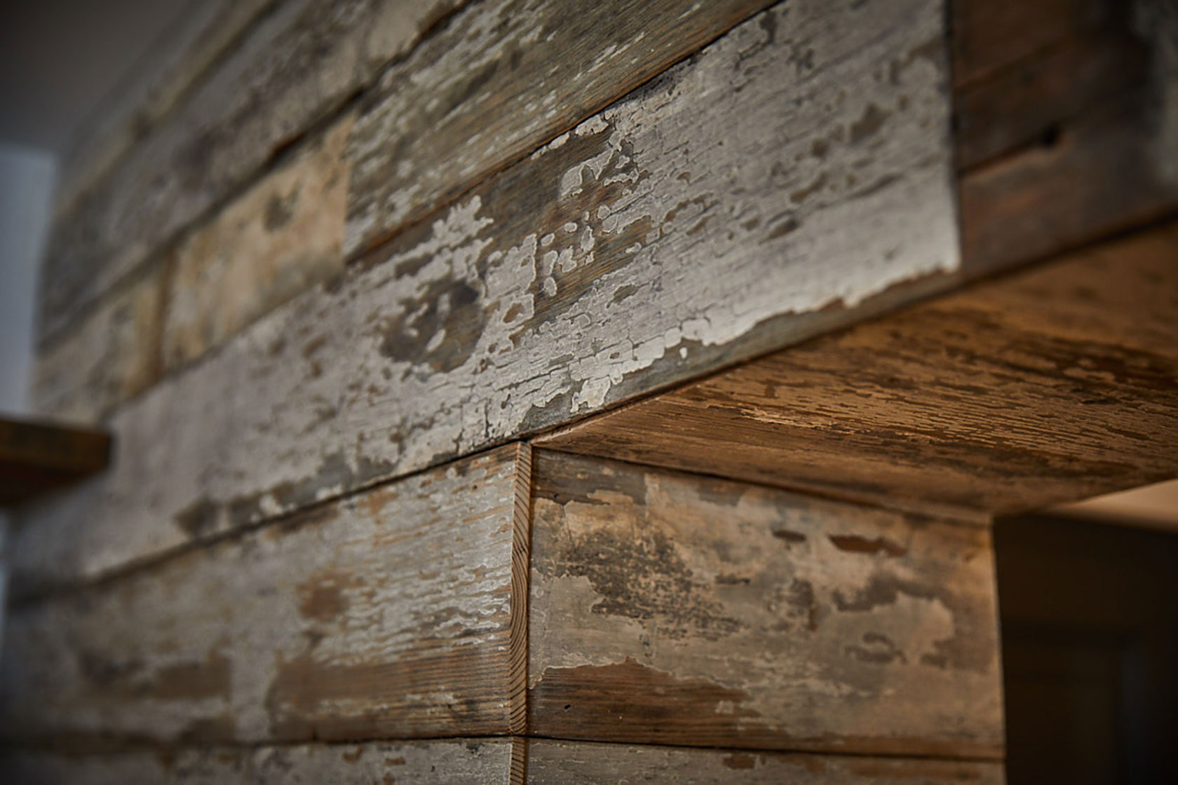 Flaky white painted reclaimed wood boards