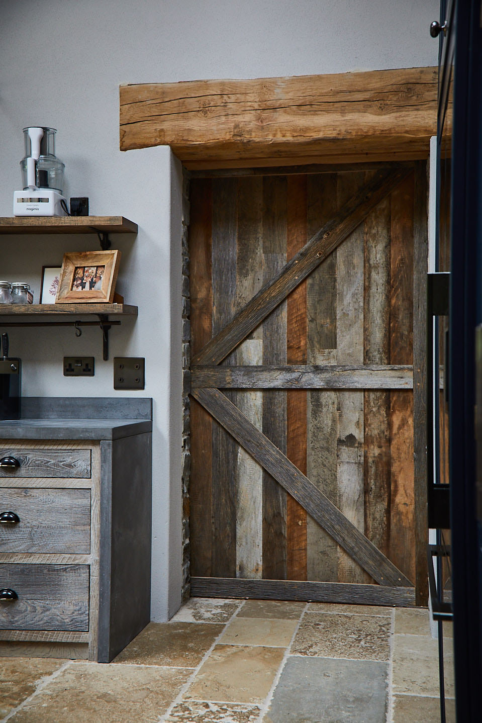 Internal closed reclaimed timber sliding barn door with cream tiles