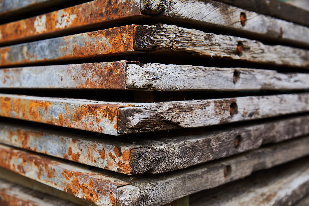 Large stack of unprocessed reclaimed oak timber wood