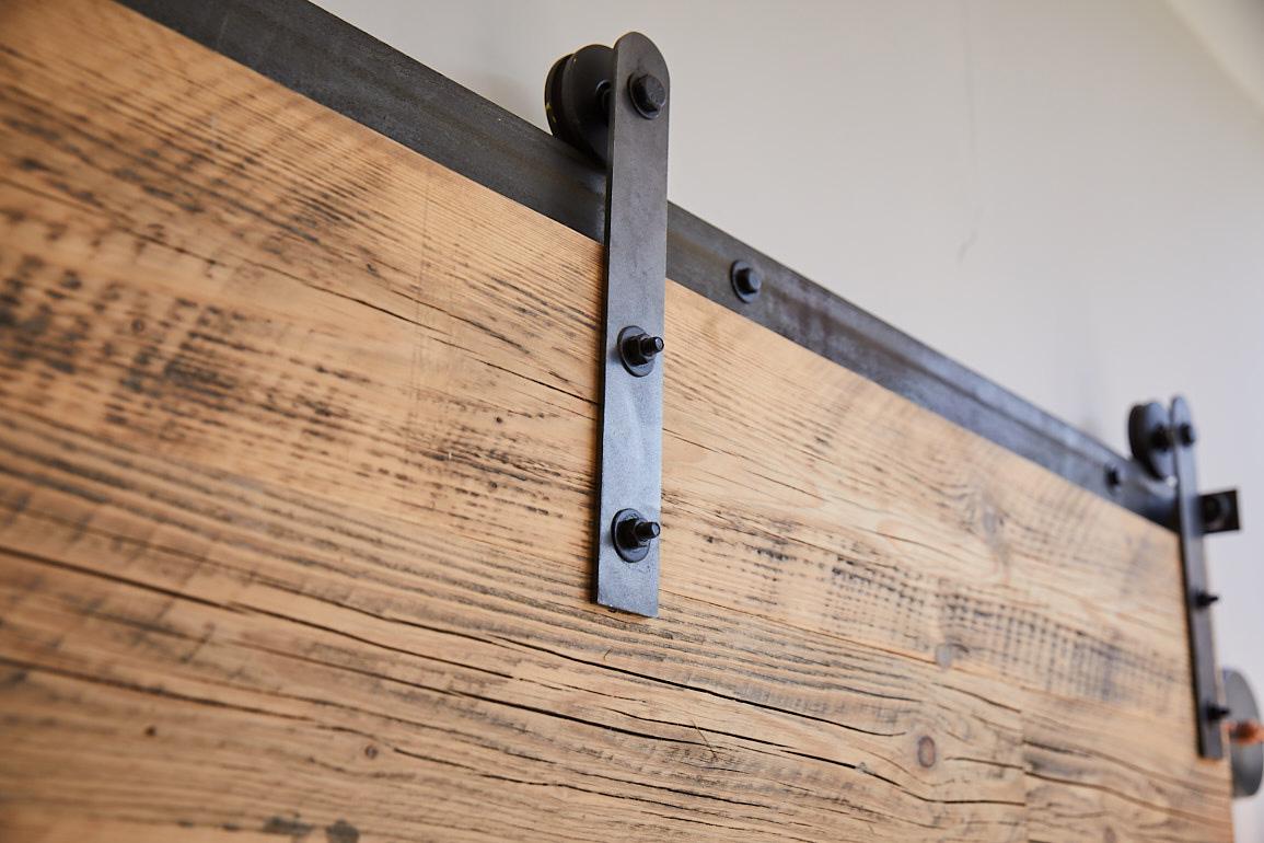 Rubbed oil steel rail for sliding barn door