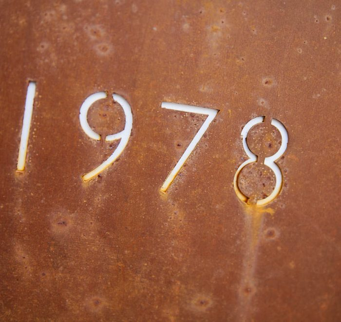 Rusted metal sign with 1978 year cut out