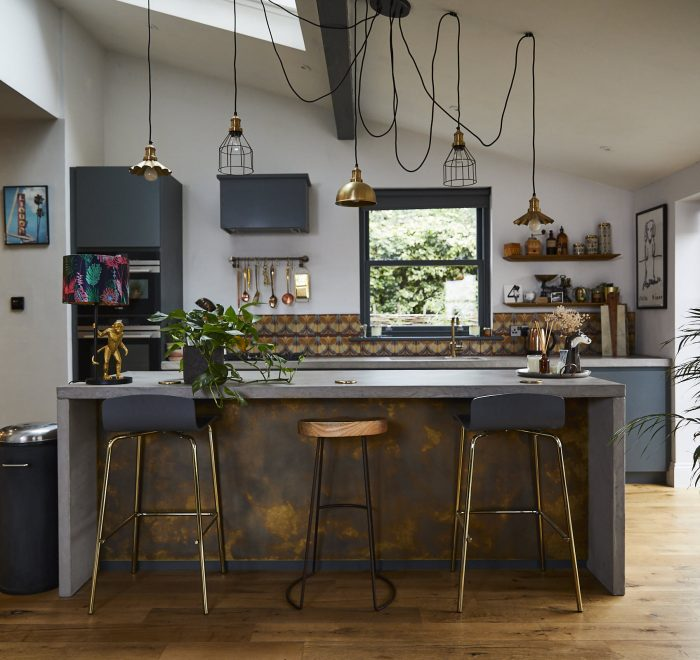 Antique brass and concrete bespoke kitchen island with bar stools