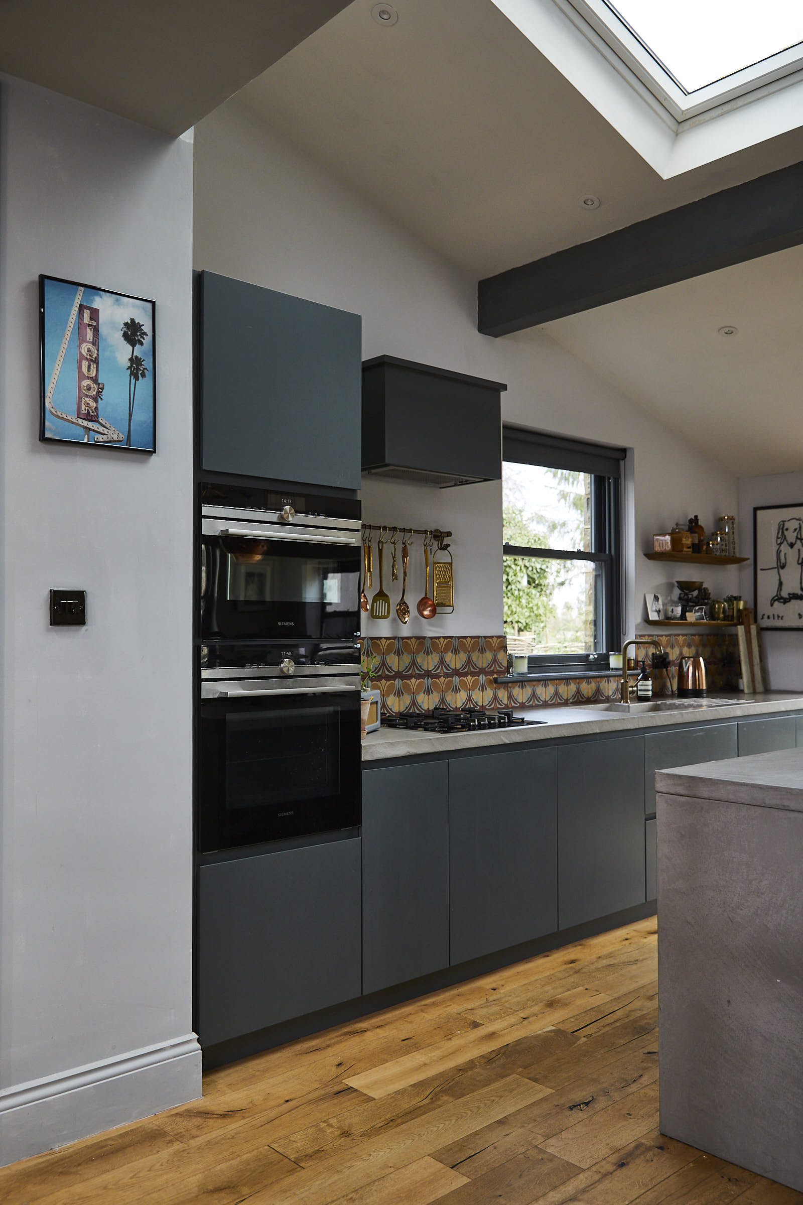 Integrated Siemens eye level ovens in slab painted tall kitchen units