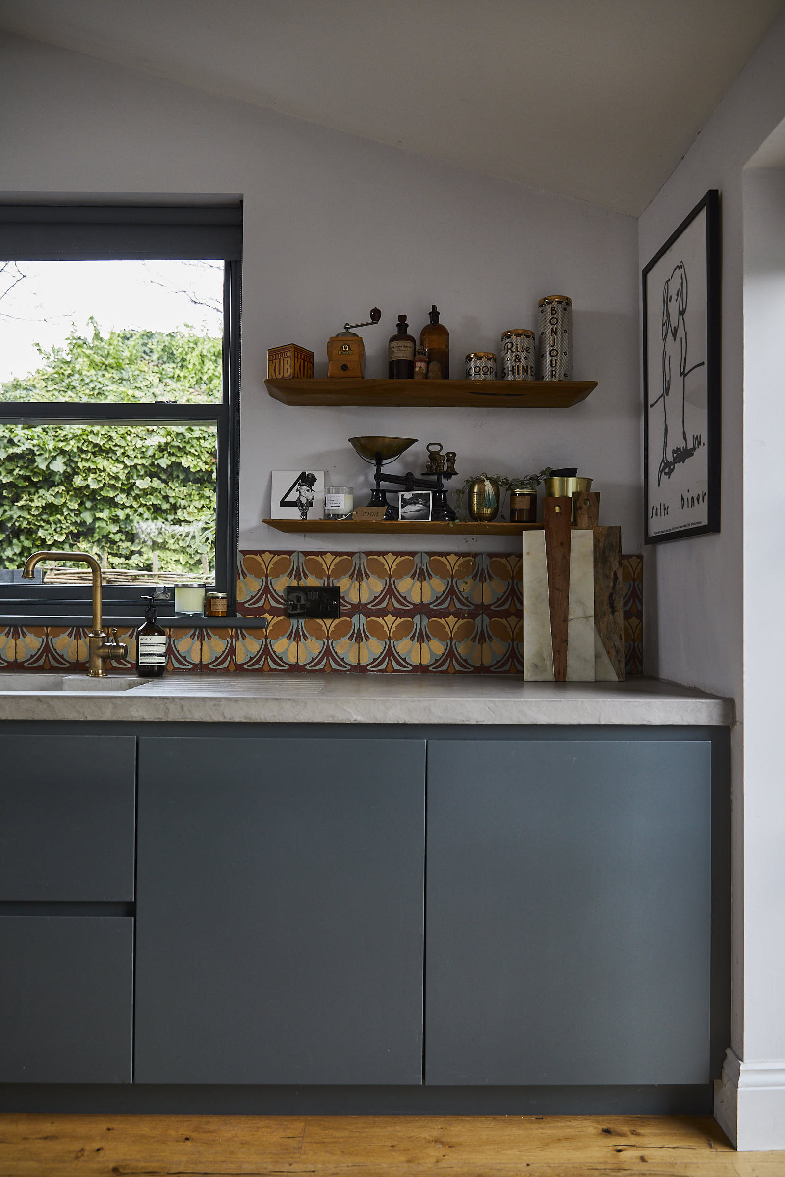 Painted Little Greene slab double door kitchen units with concrete worktops and open shelves