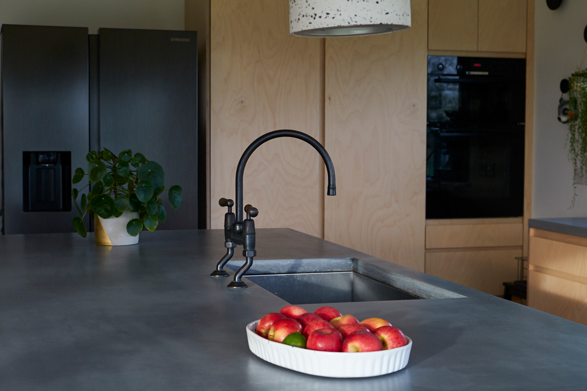Fruit bowl rests on concrete island worktop