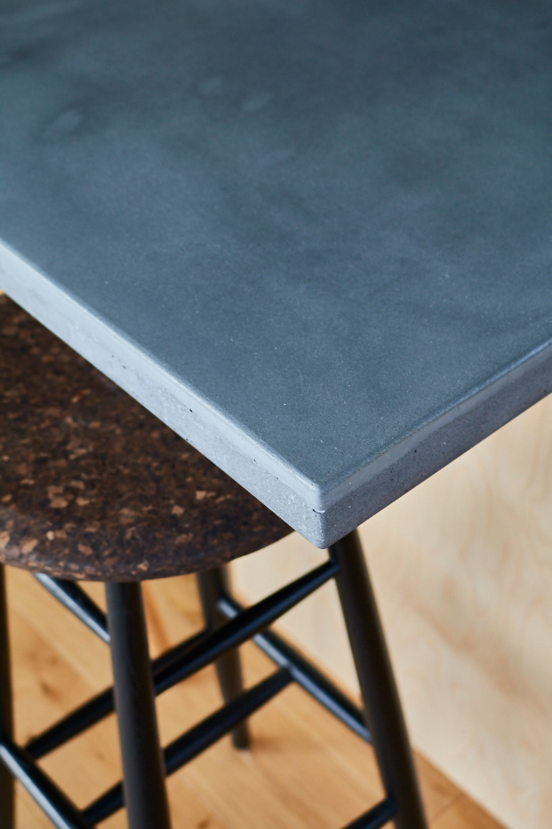 Island worktop corner made from solid grey concrete
