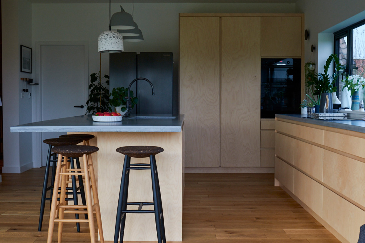 Solid oak bar stool with bespoke kitchen island and concrete worktop