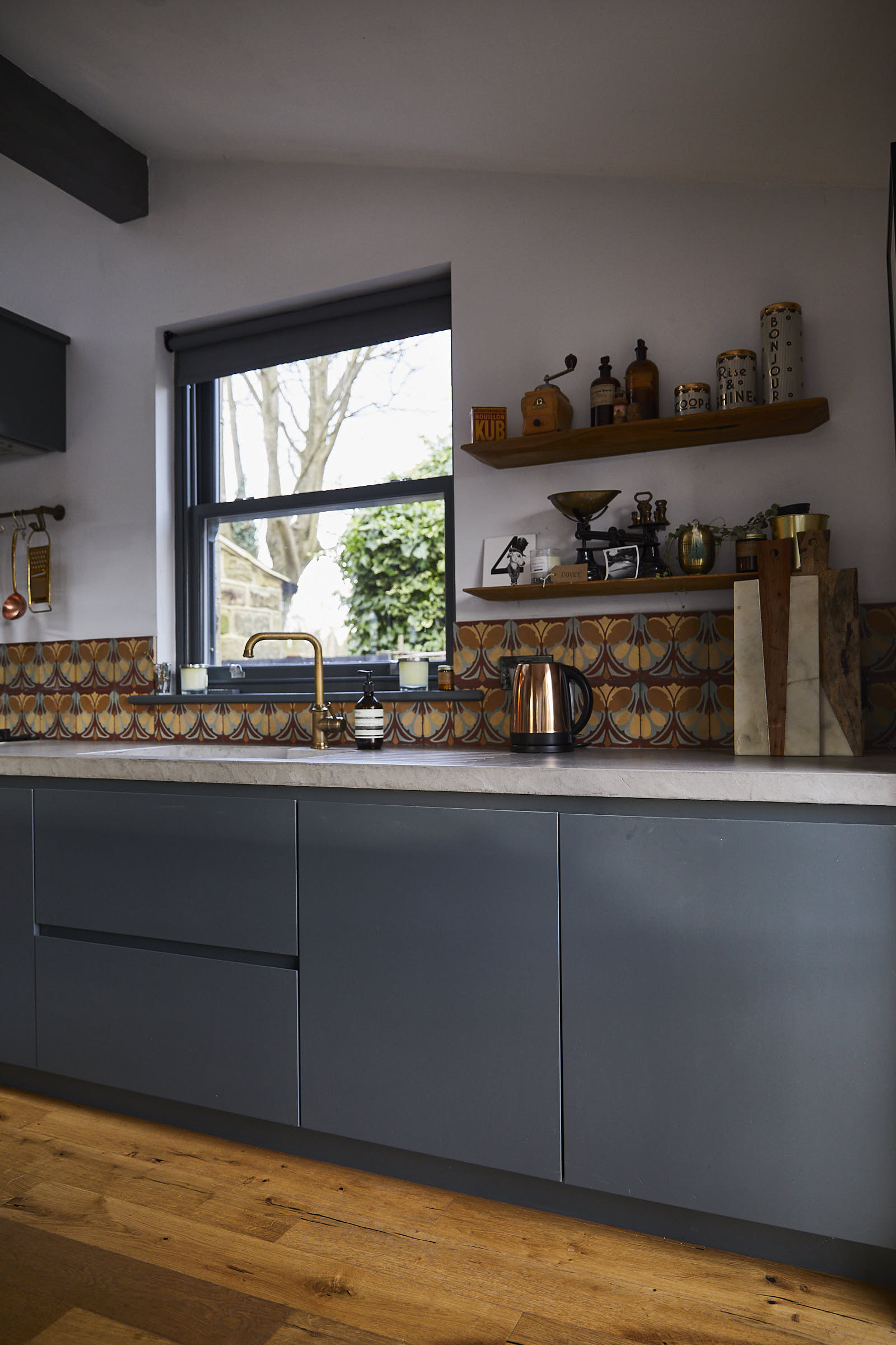 Painted bespoke kitchen units with integrated sink and solid concrete worktops