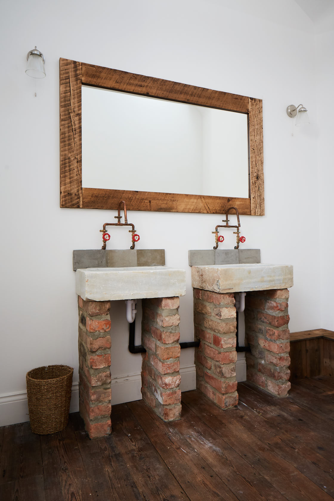 Concrete sinks on bricks with copper pipe taps