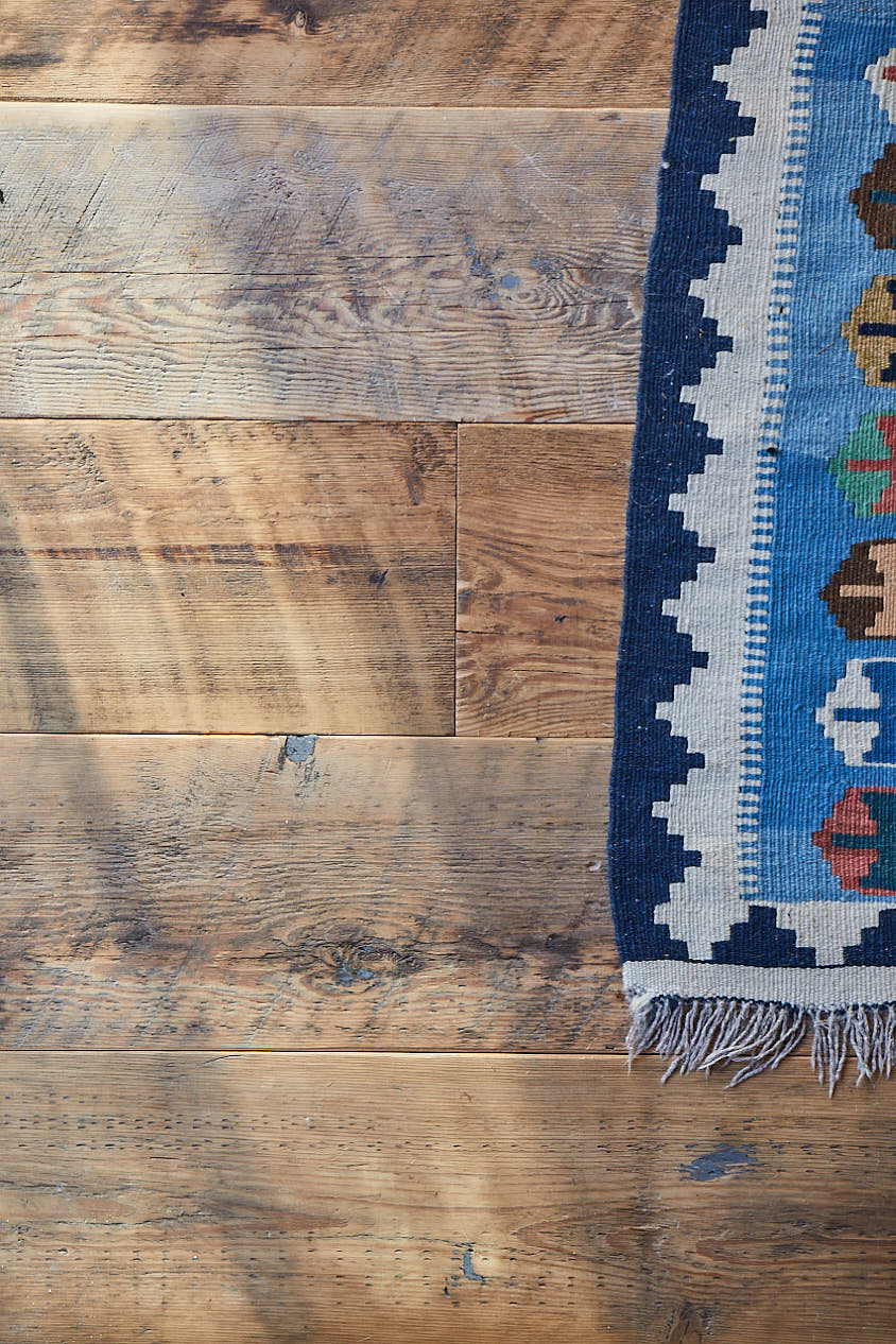 Kashgai rug with reclaimed flooring