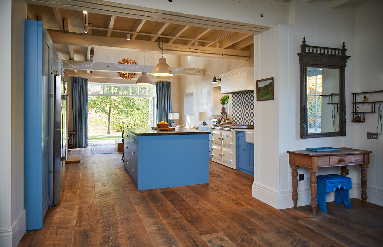 Light blue kitchen with pine flooring