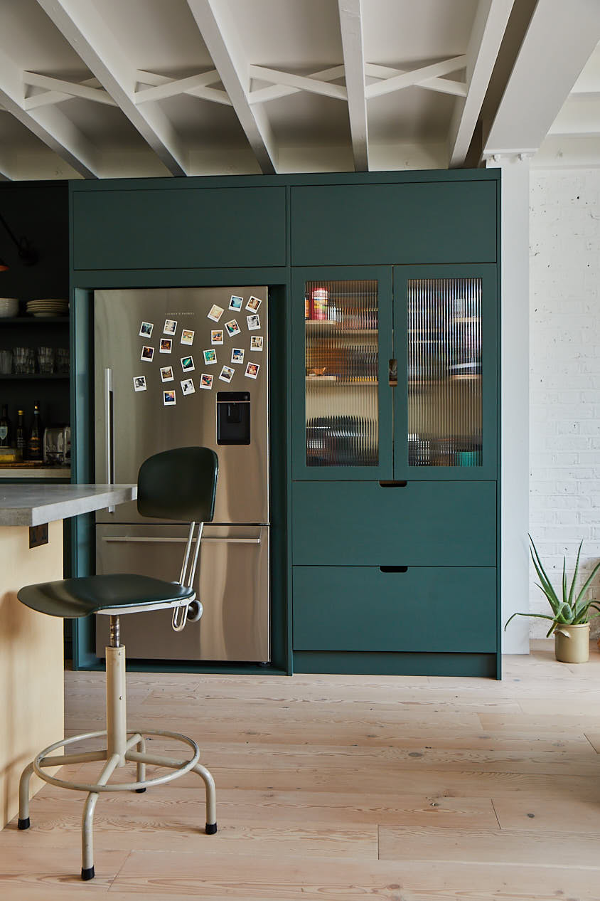 Green glass pantry with stainless steel fridge freezer
