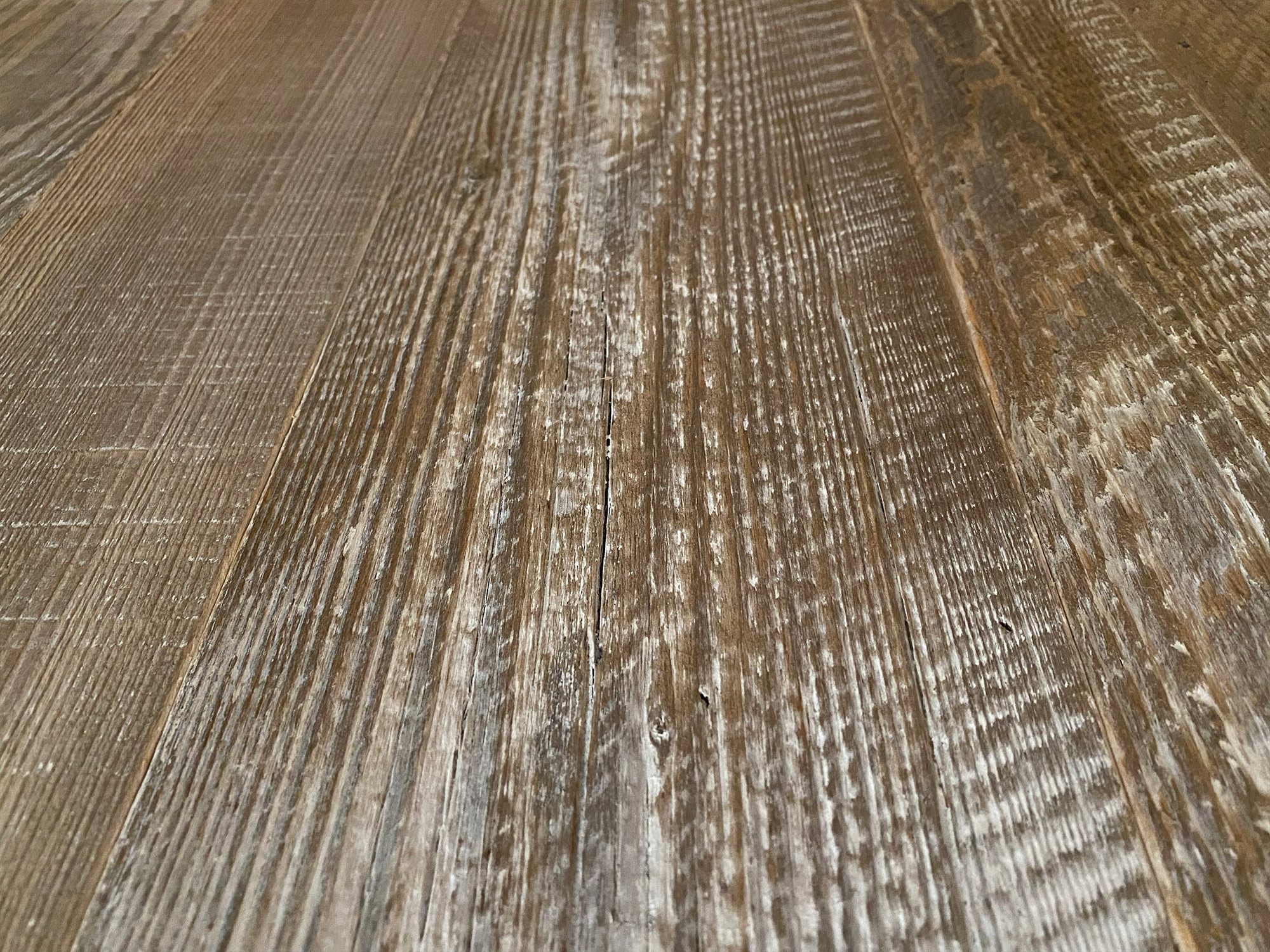 Reclaimed spruce flooring with whitewash paint