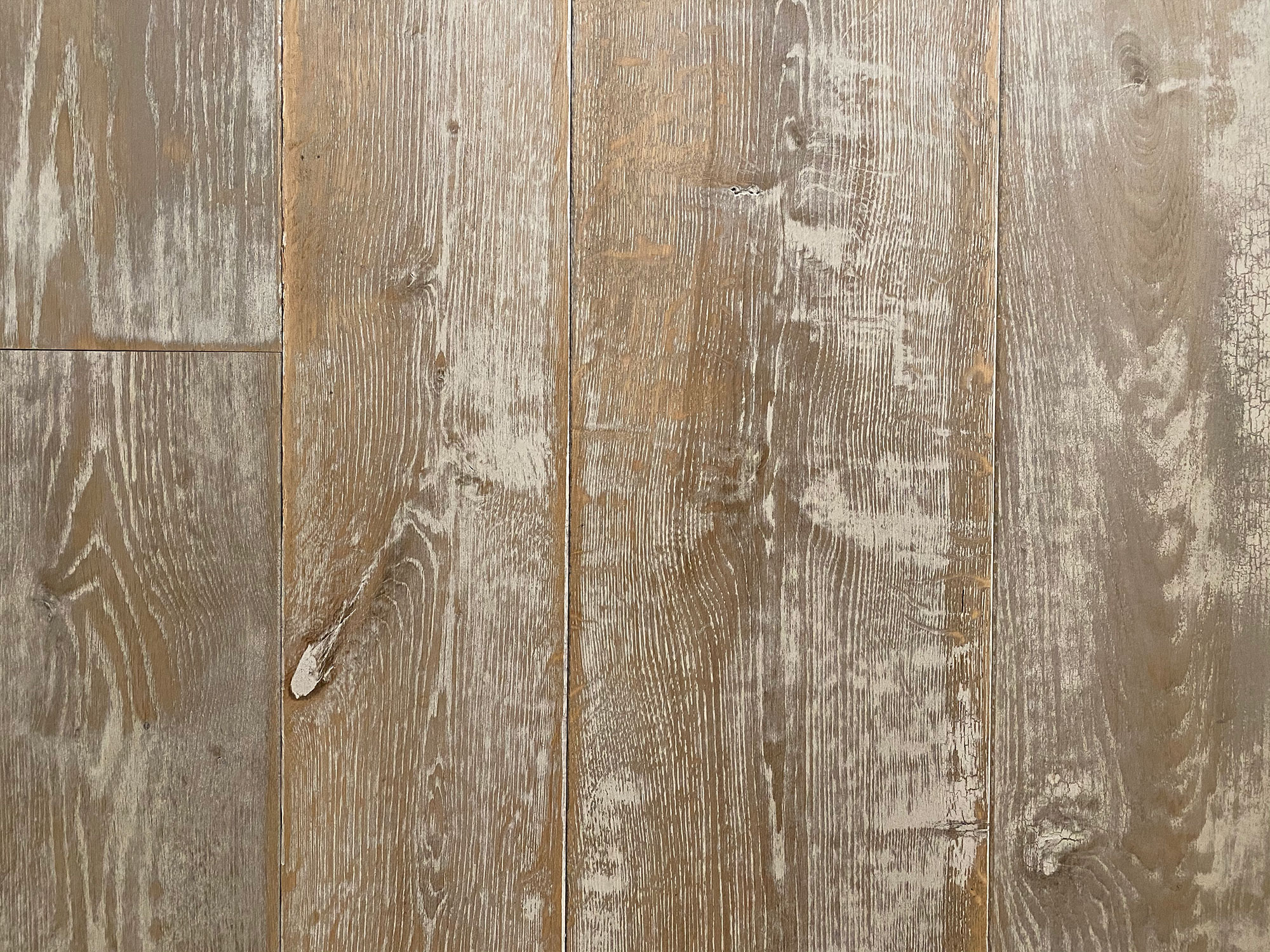 Crackled paint on oak flooring