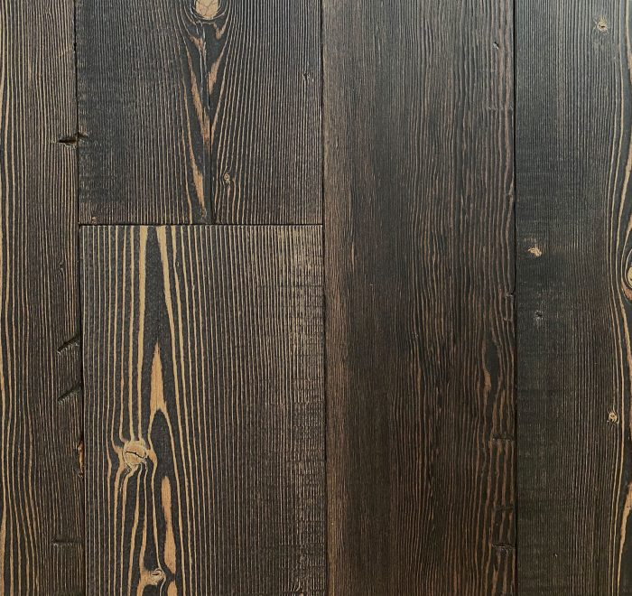 Black reclaimed floor boards