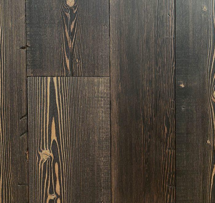 Black reclaimed floor boards