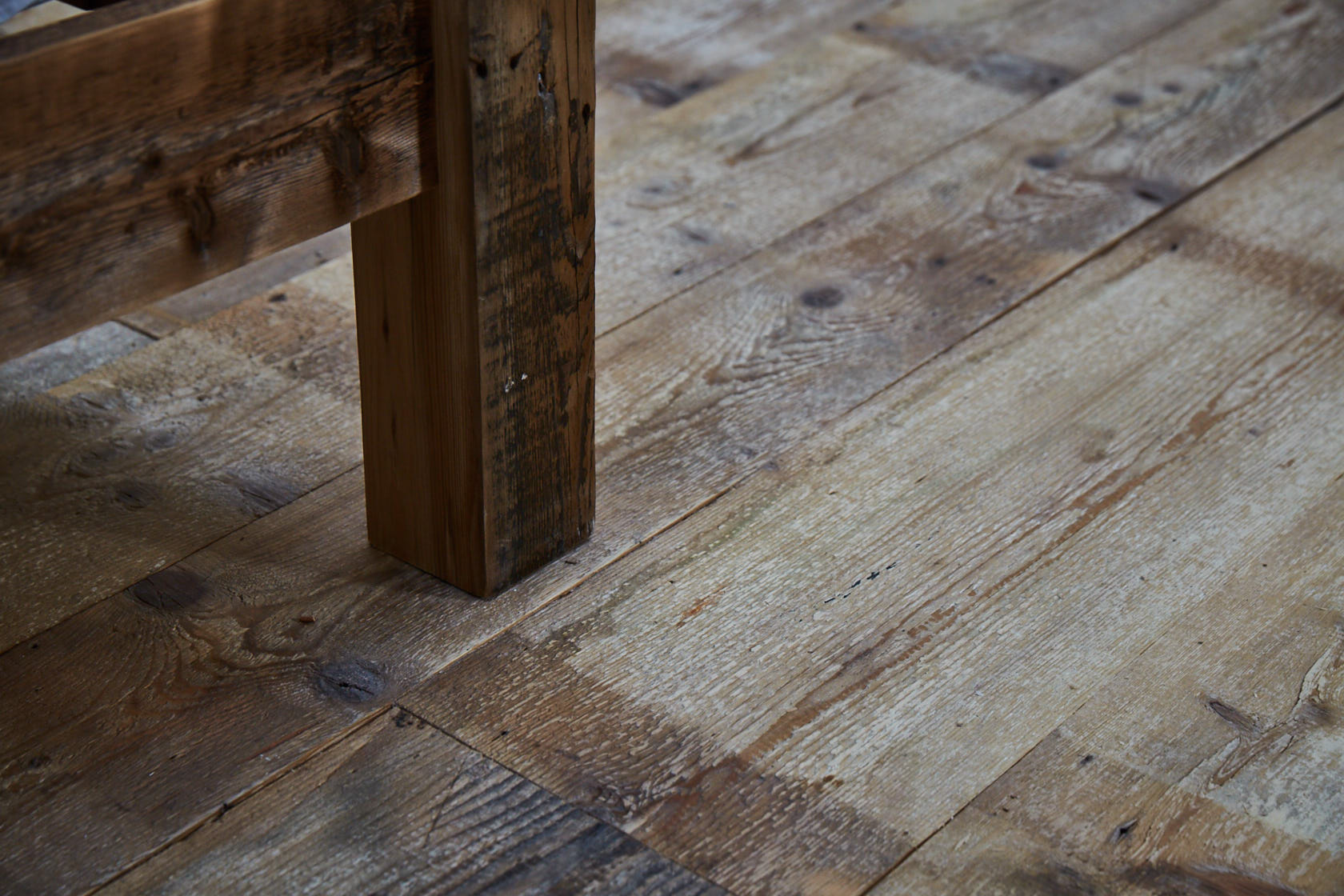 reclaimed pine flooring with rustic pine foot of bed