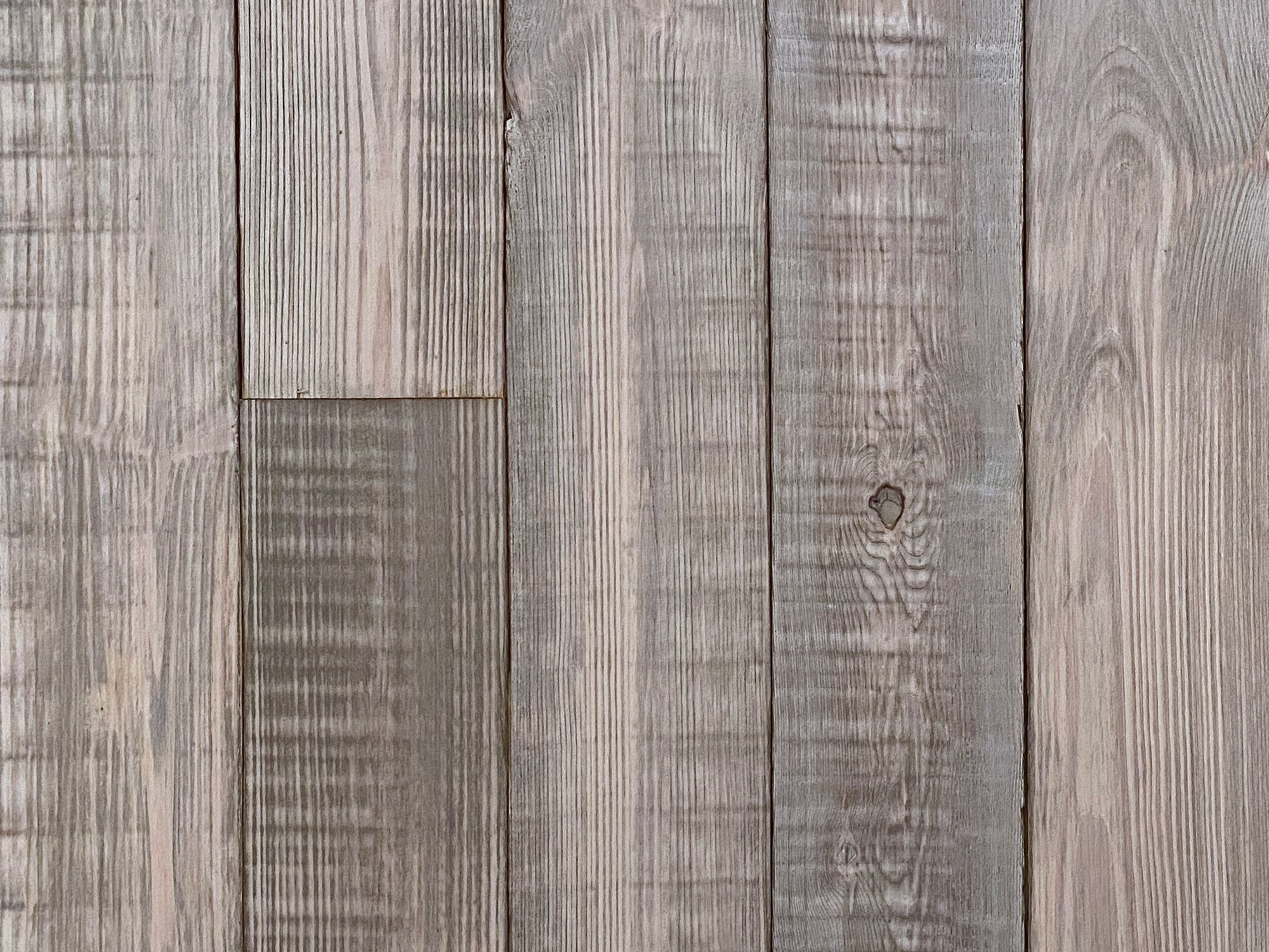 Reclaimed grey white mill board cladding