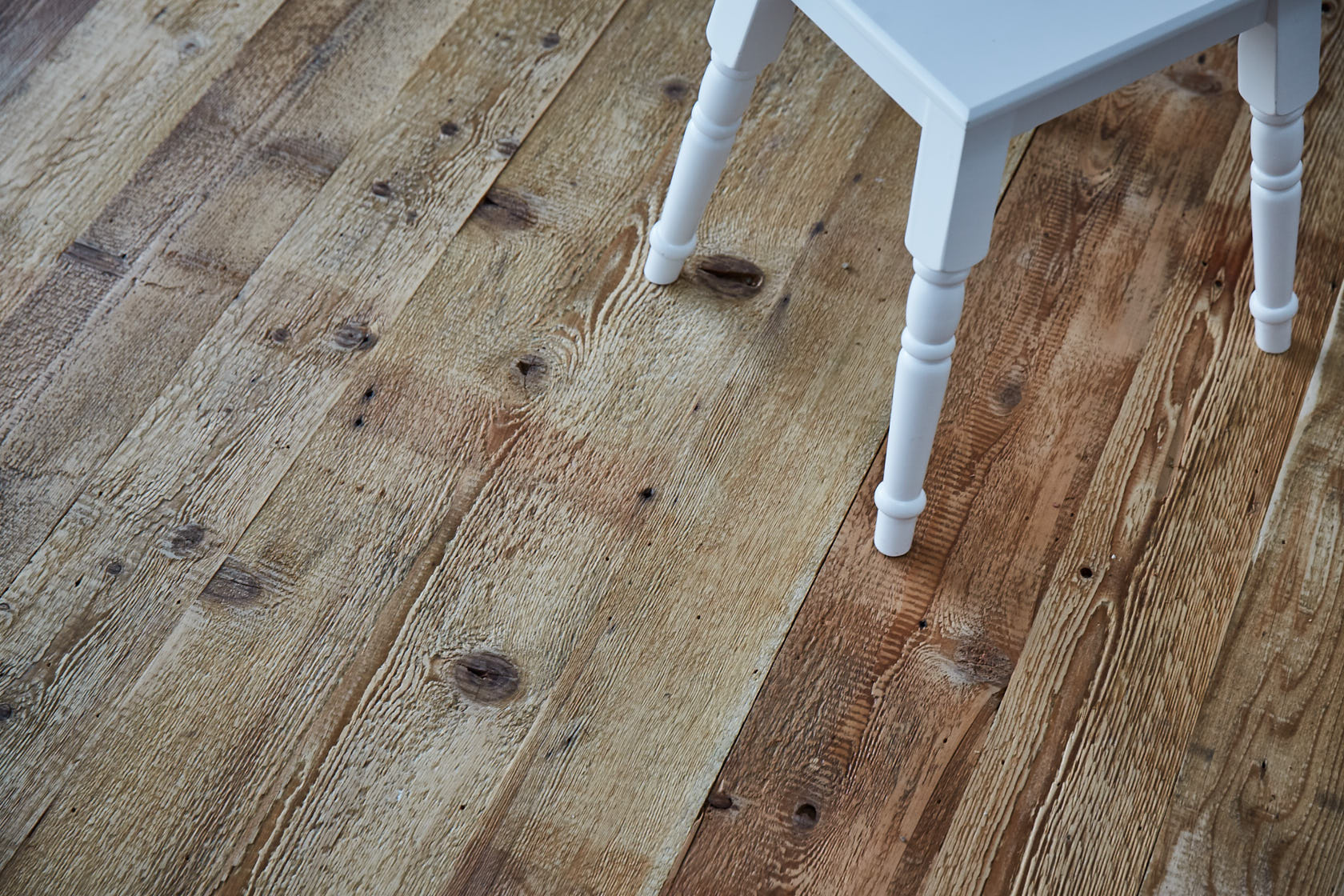 Industrial mill board flooring with white painted stool