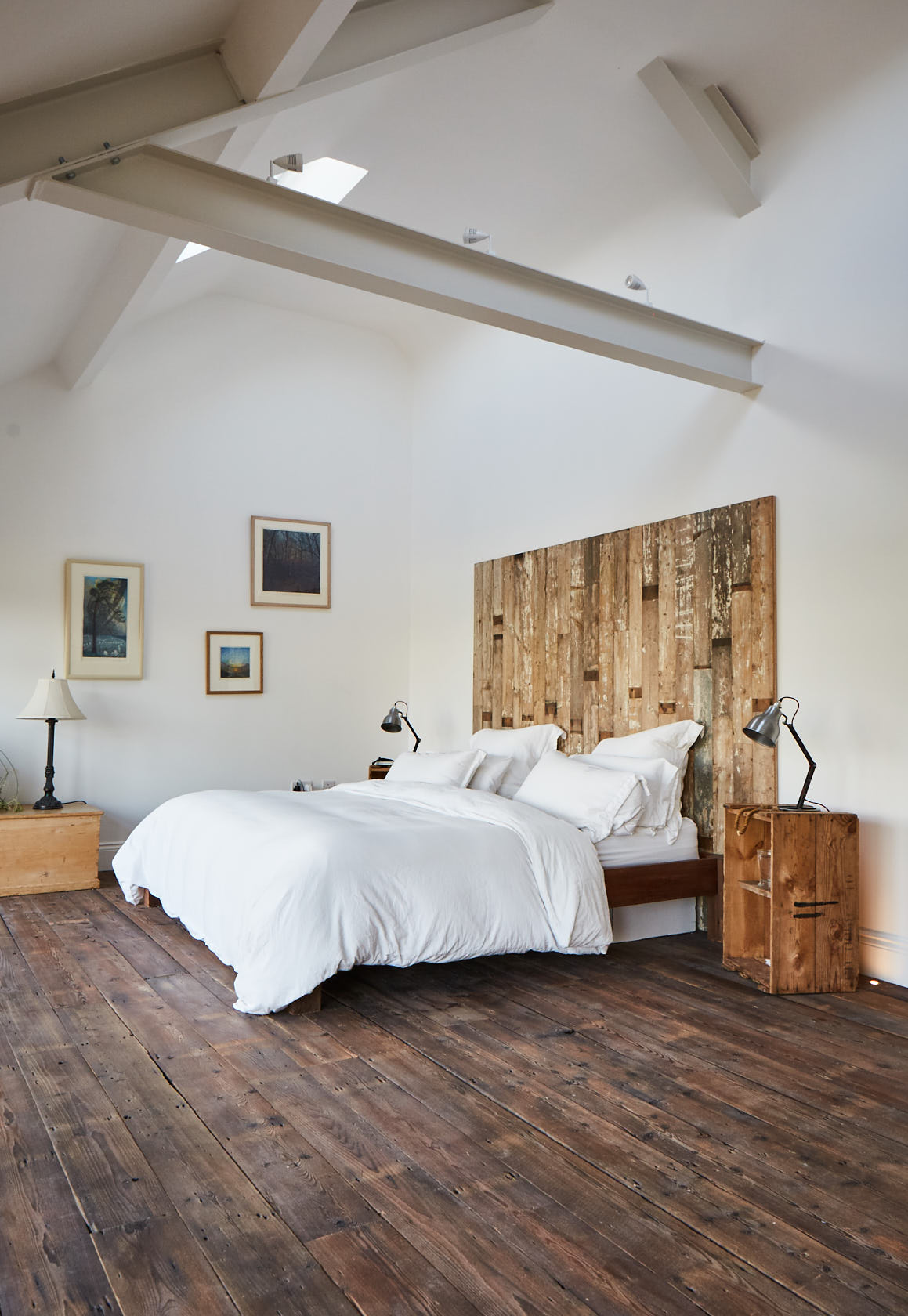 White double bed with reclaimed head board