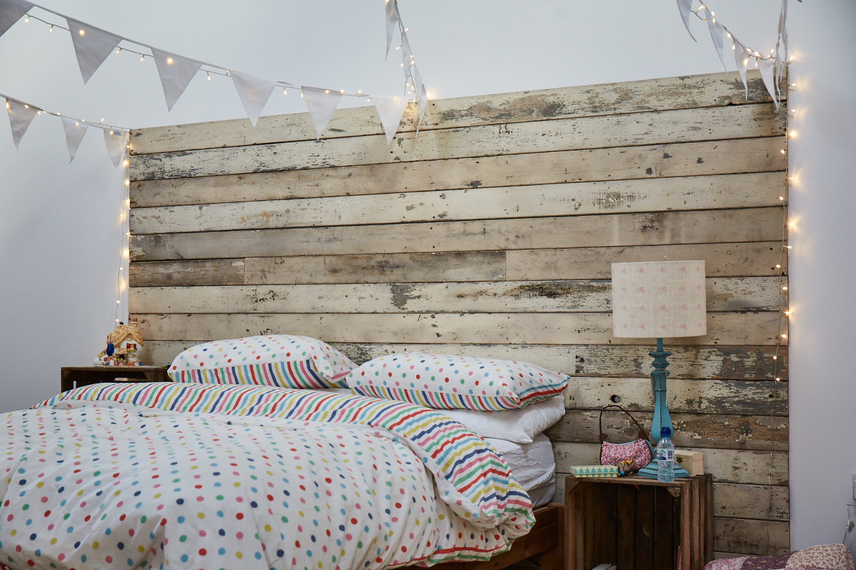 Flaky rustic cladding make head board of bed