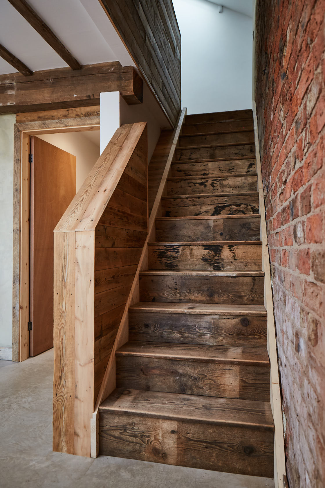 Stairs clad in reclaimed timber