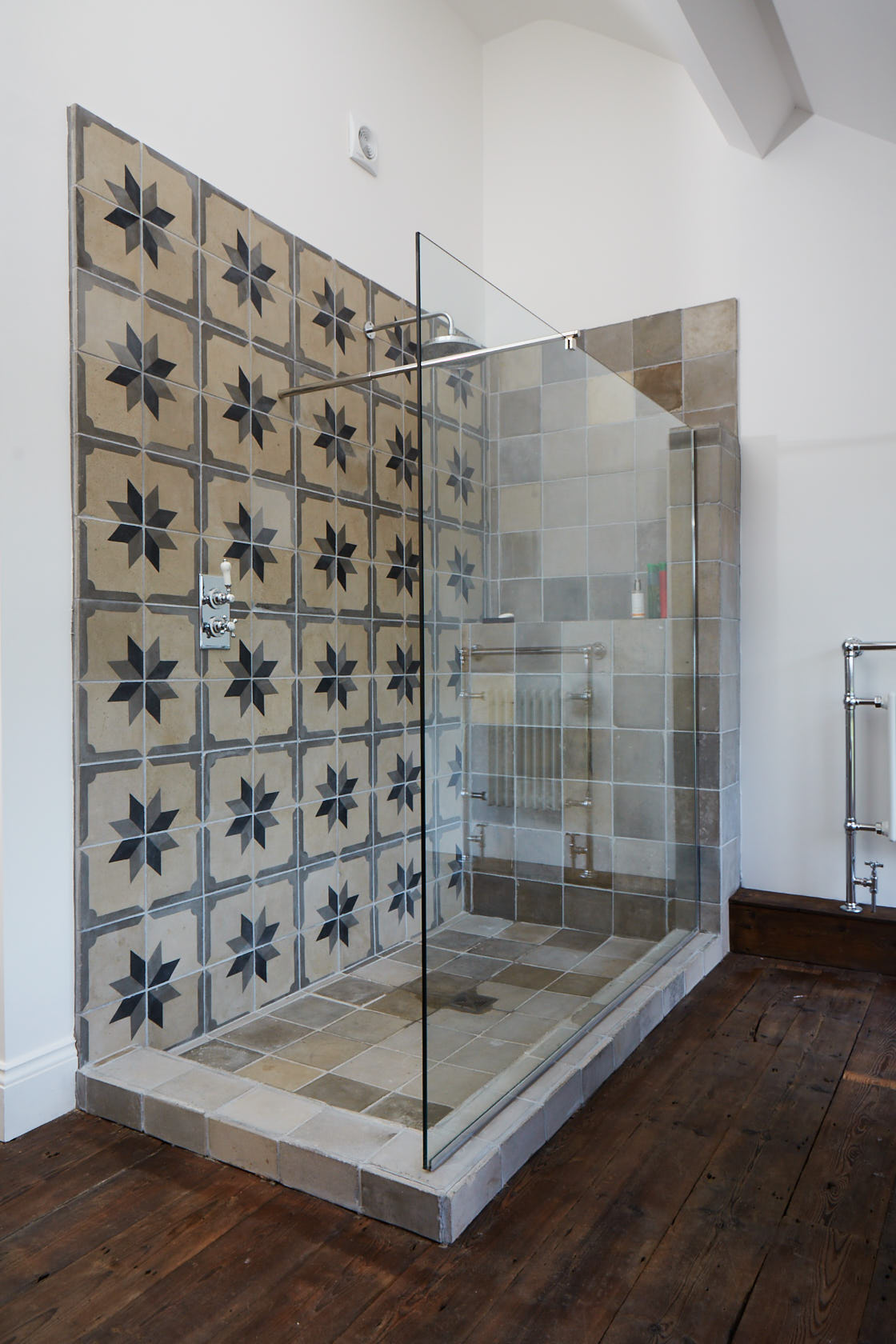 Tiled shower with concrete base