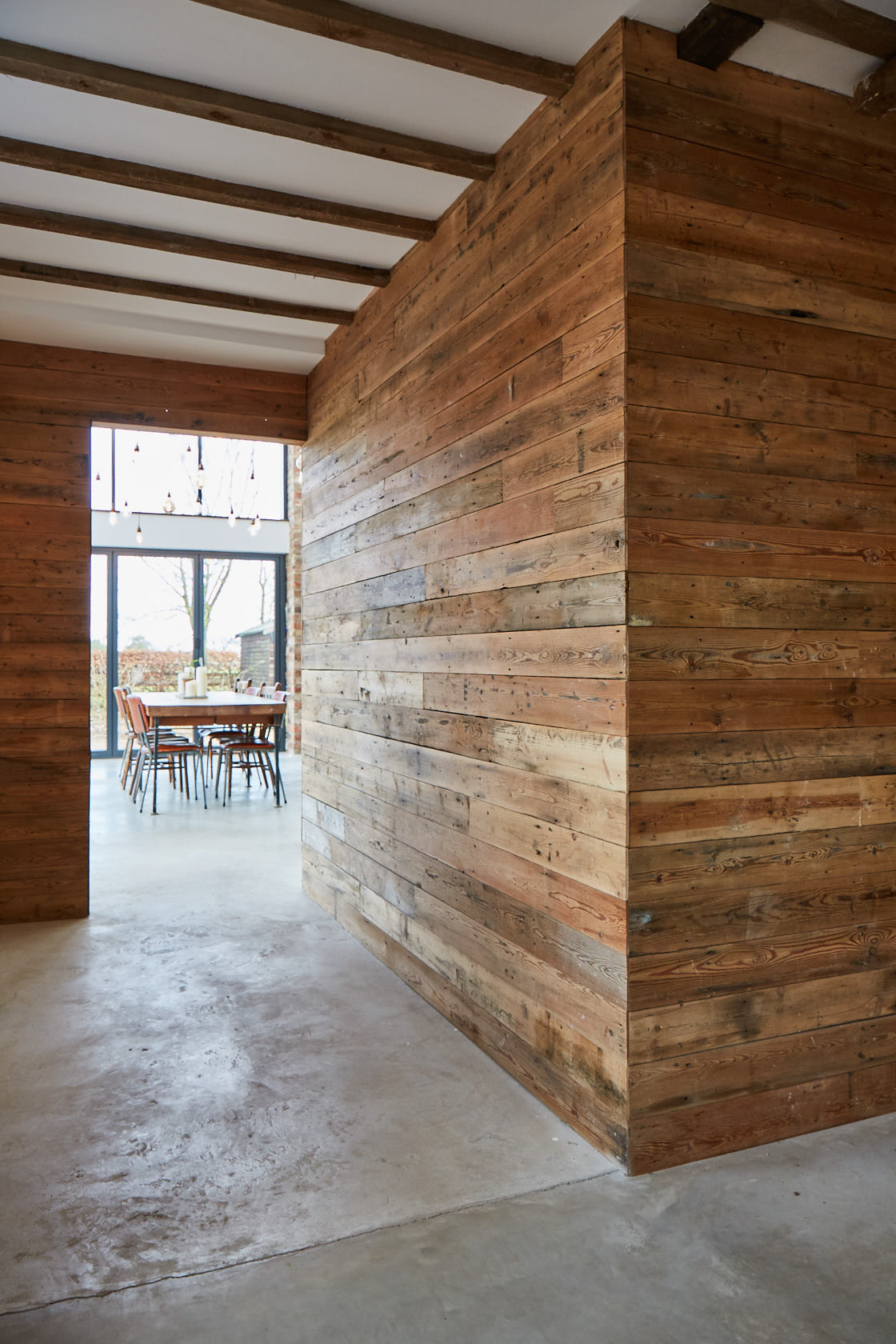 Large wall cladded in reclaimed pine timber