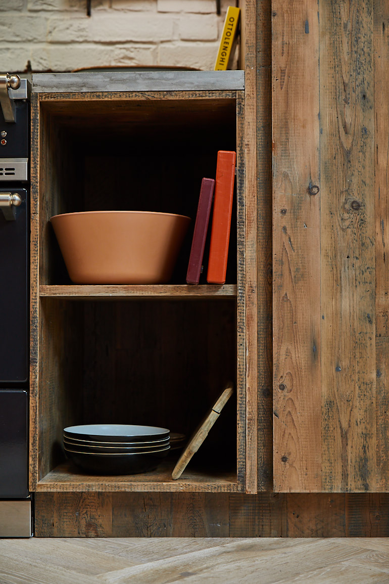 Open shelving unit with bowls and chopping boards