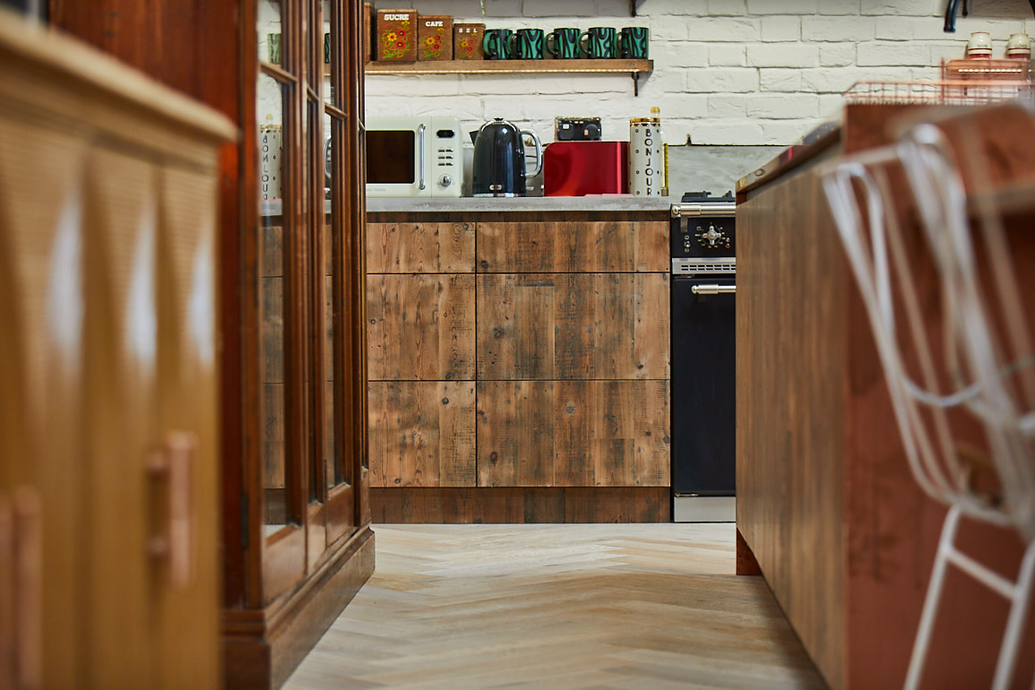 Reclaimed kitchen drawers sit next to black Lacanche Macon range cooker