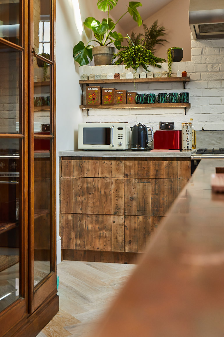 Reclaimed pan drawers and open shelves in bespoke kitchen