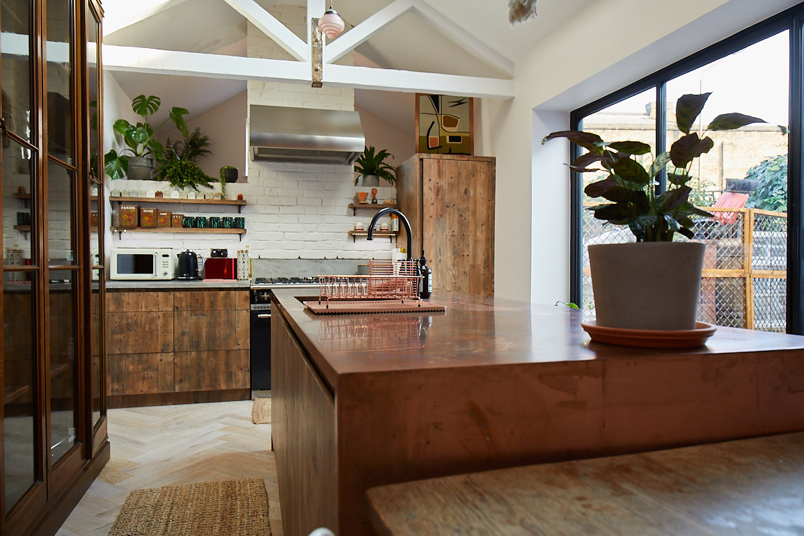 Reclaimed bespoke kitchen with copper and concrete worktops