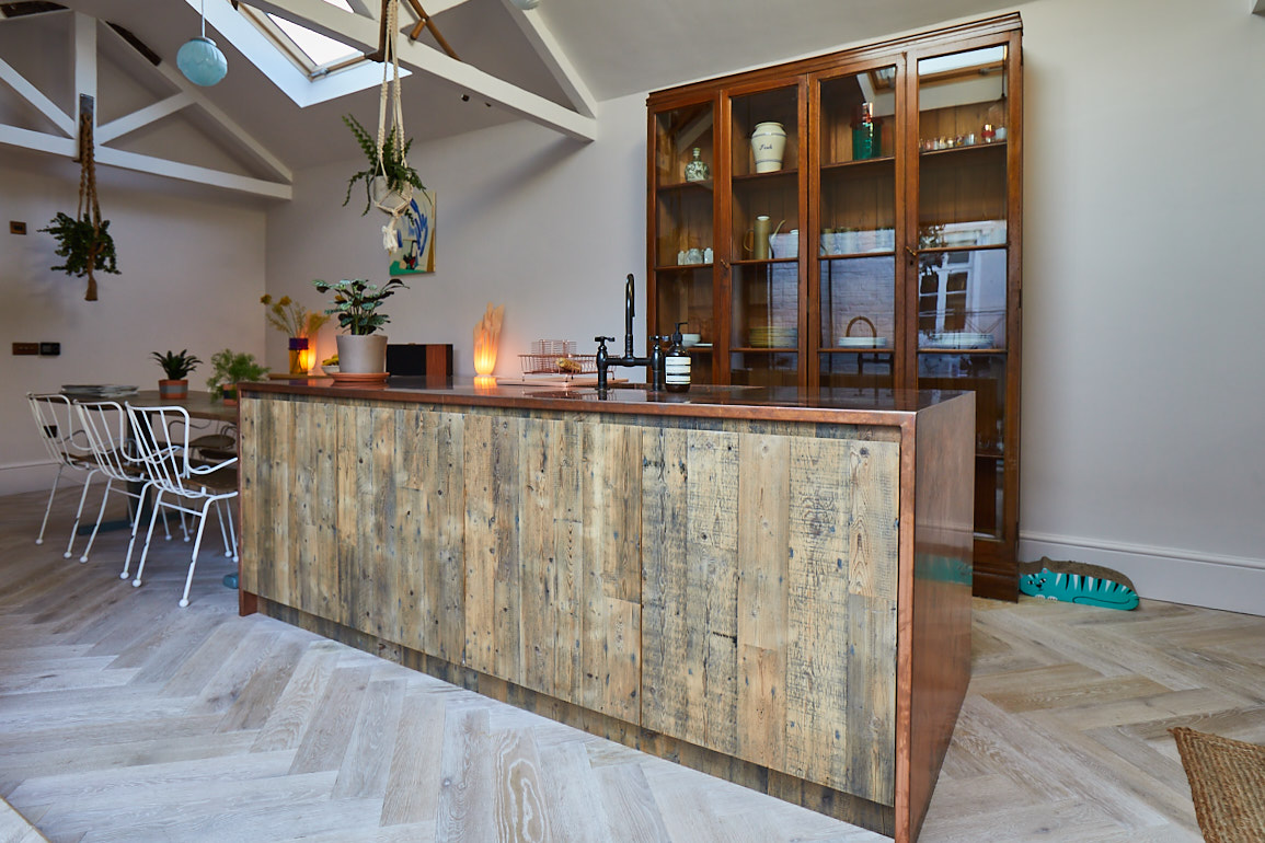 Engineered kitchen island with reclaimed pine and copper worktop