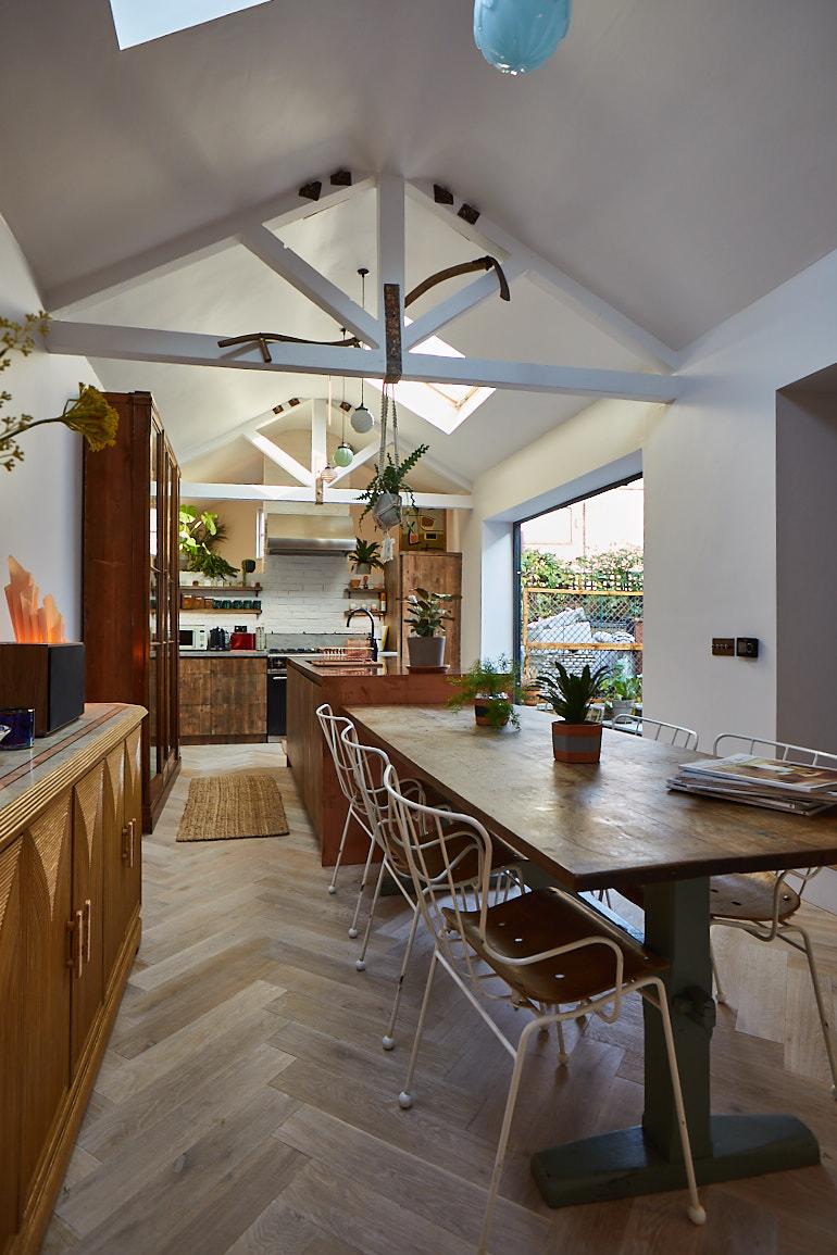 Open plan bespoke kitchen with parquet flooring