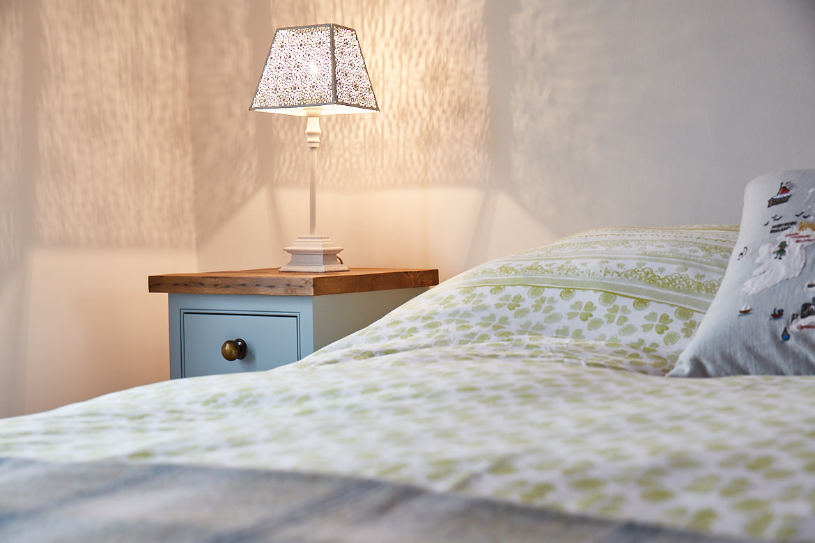 Blue painted bed side table with rustic pine worktop