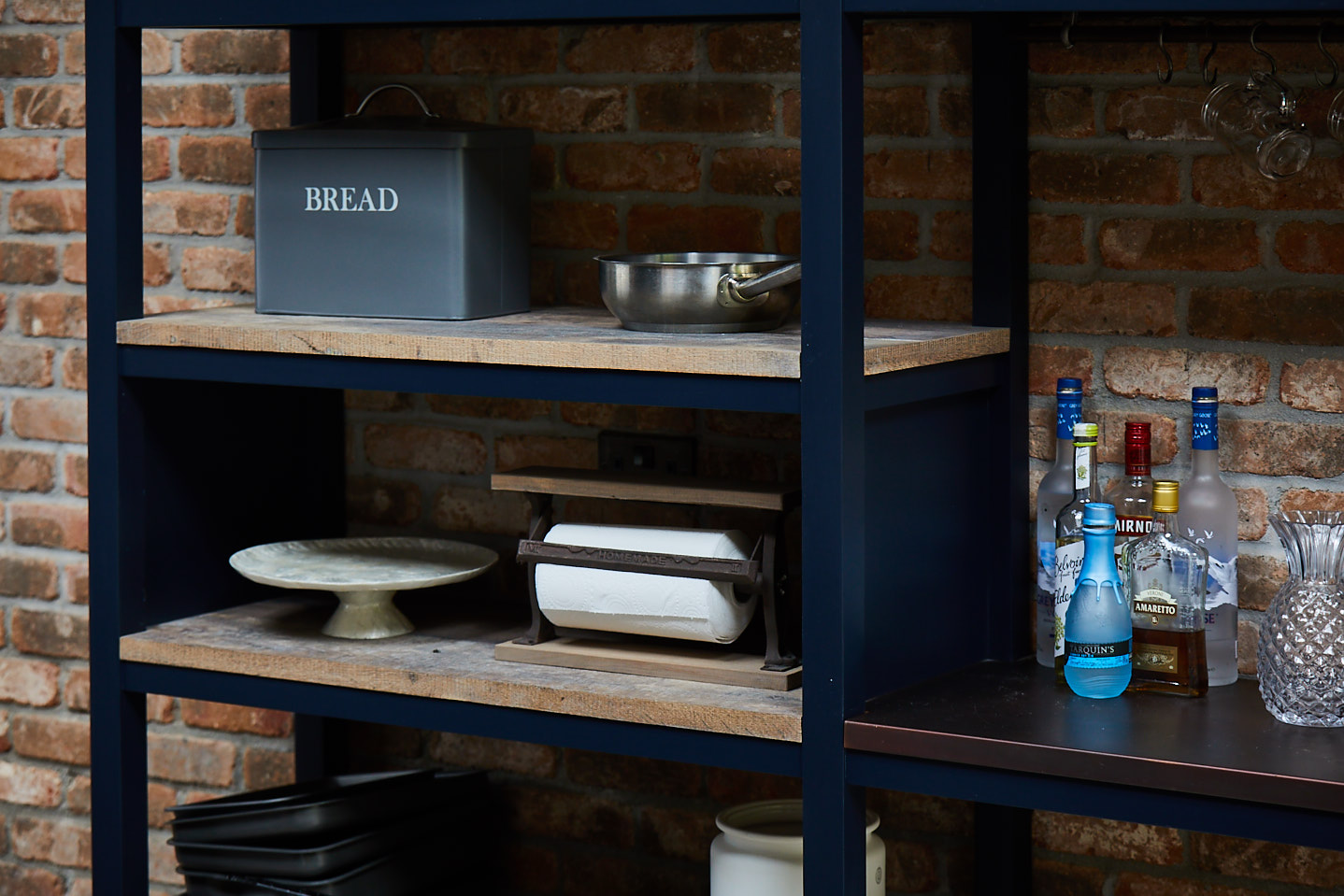 Items on industrial open shelving unit painted basalt by Little Greene