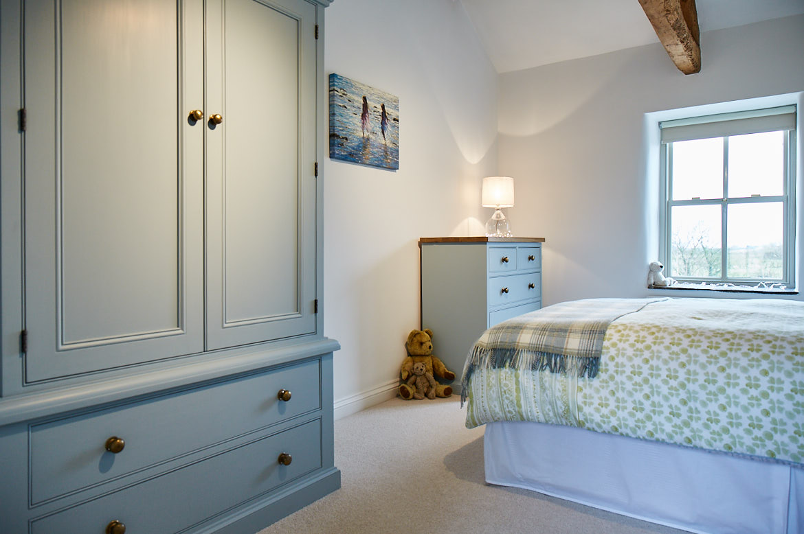 Blue wardrobe and chest of drawers