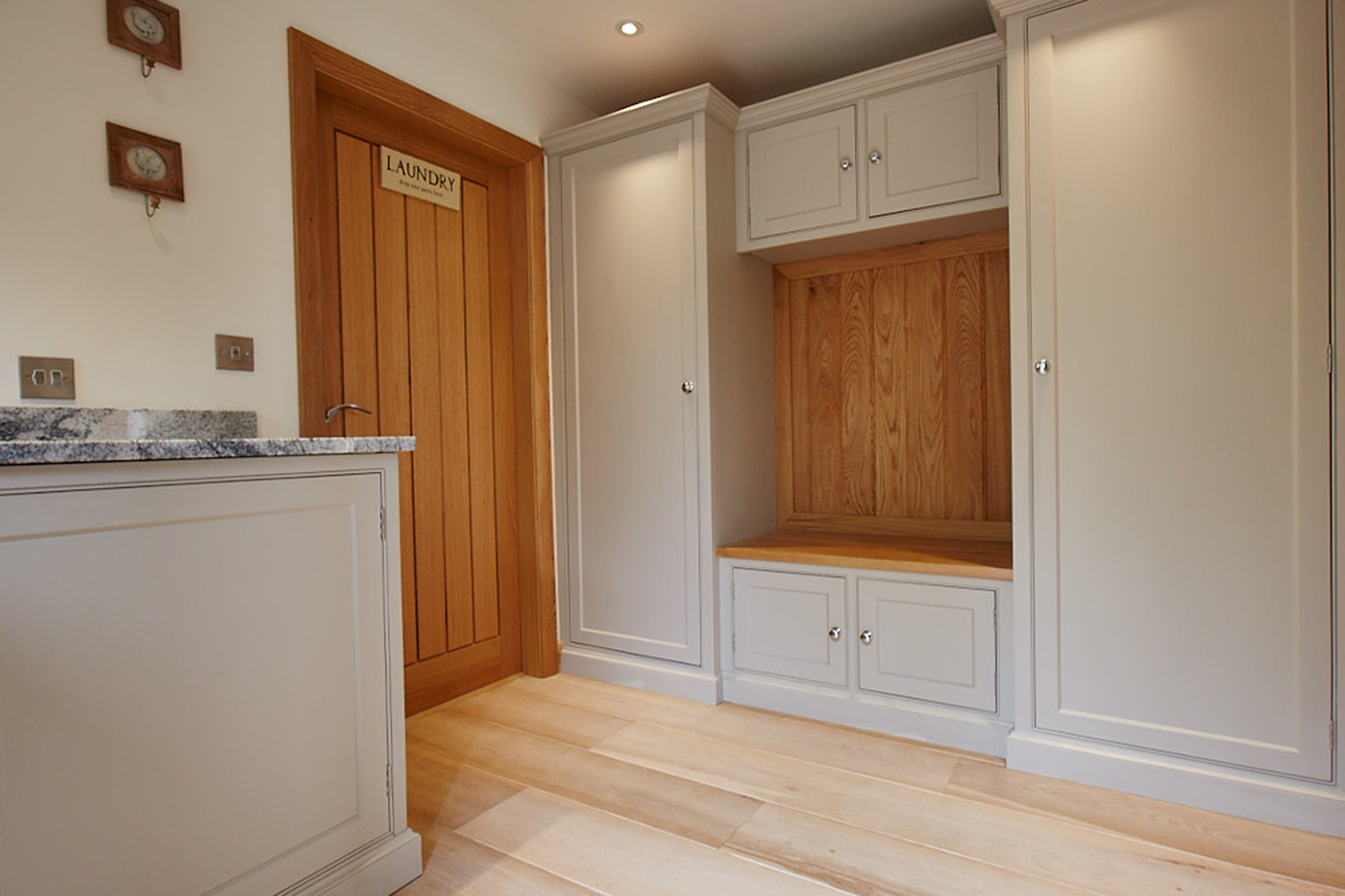 Laundry room with fitted units and seating area made from solid oak