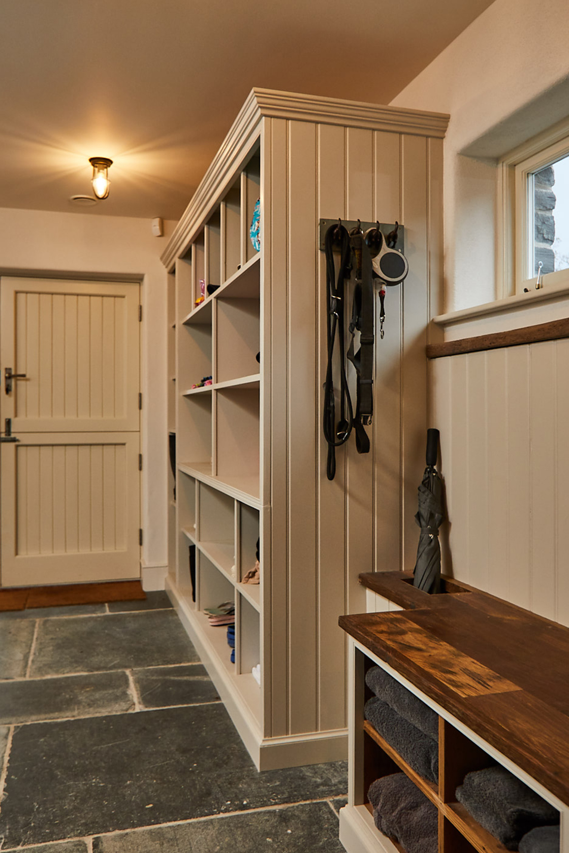 Light grey painted boot cupboard fully fitted in farmhouse