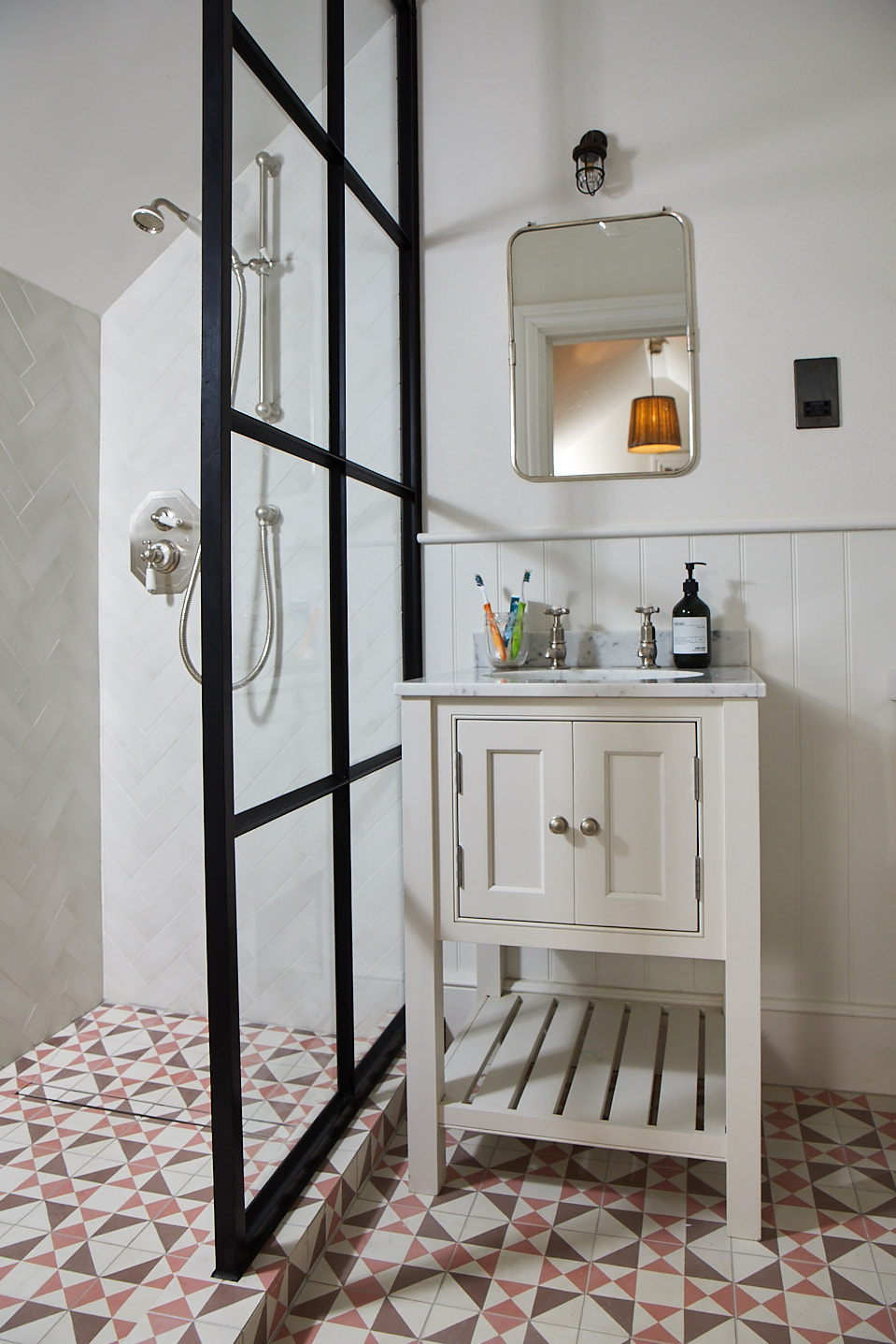 Painted vanity unit next to crittall shower screen