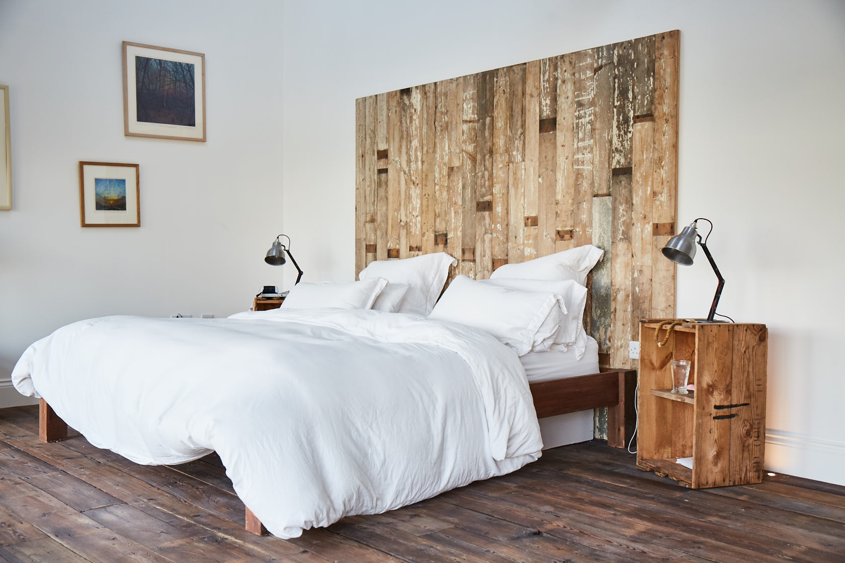 Double bed with reclaimed rustic headboard