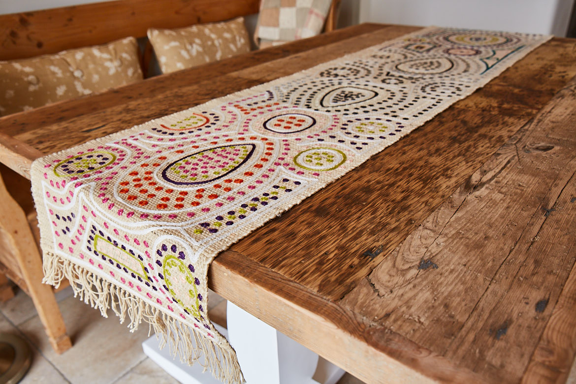 Reclaimed table top with colourful runner