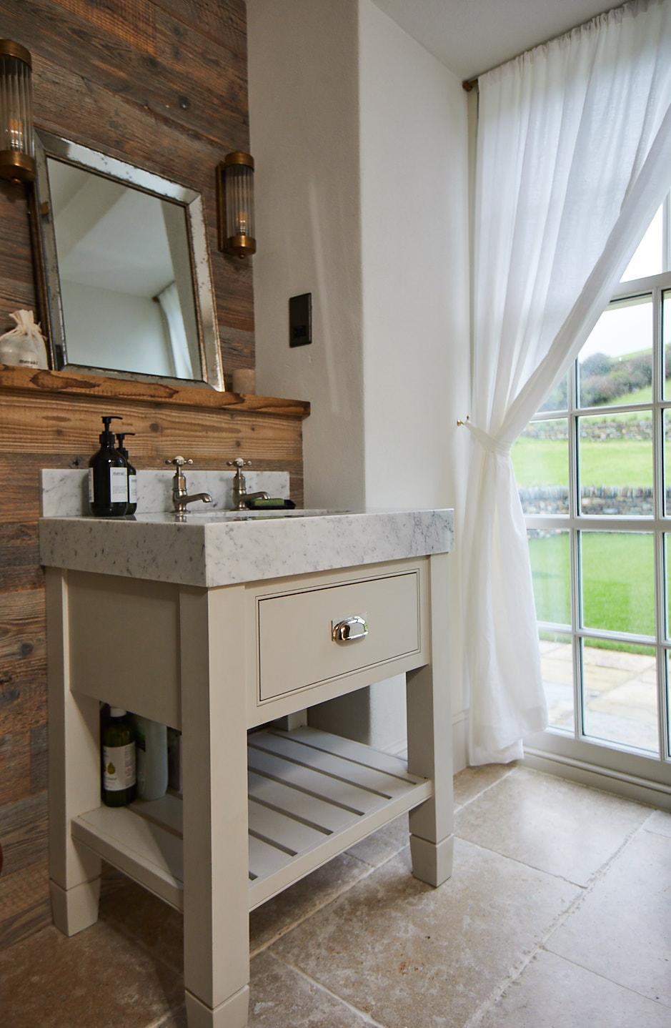 Single painted vanity unit with chunky quartz worktop