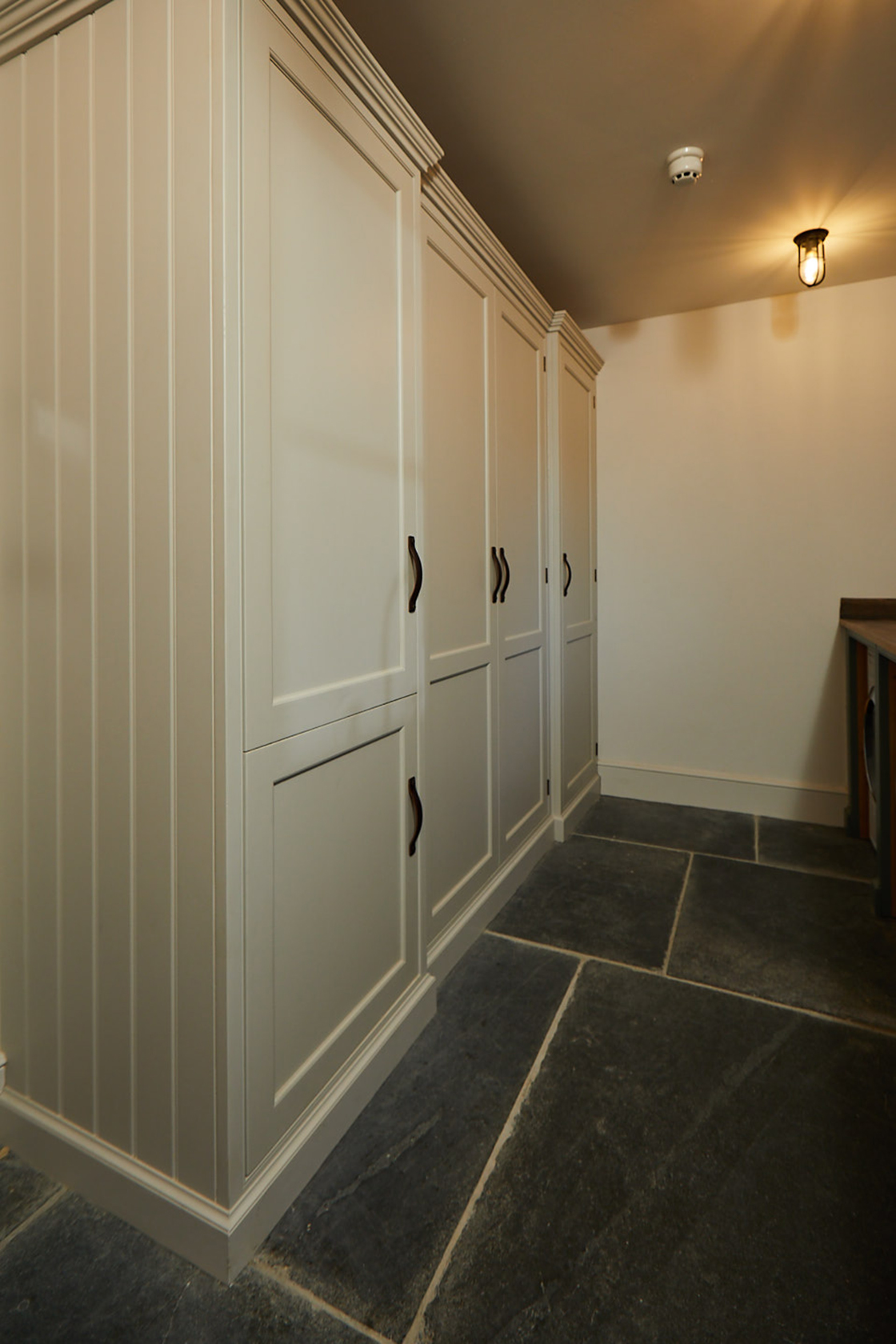 Tall integrated painted shaker cupboards with integrated washing machine and dryer