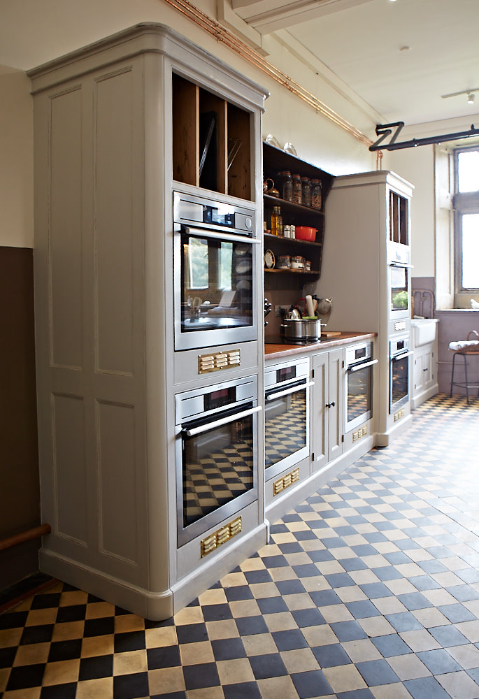 Traditional painted cabinets with integrated ovens