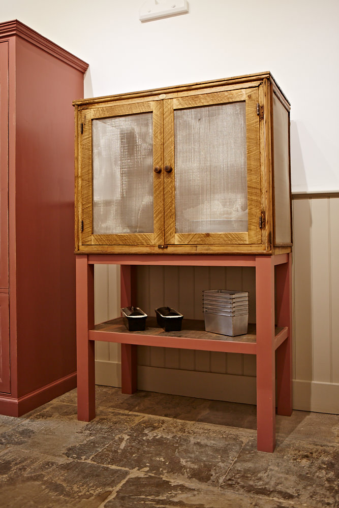 Restored double door cabinet with red painted legs