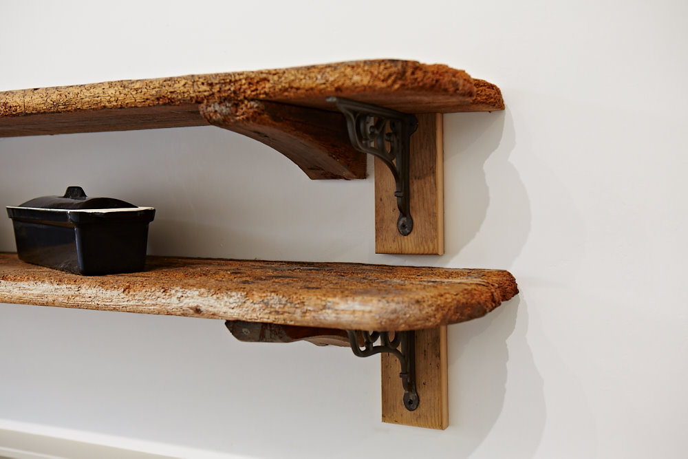 Reclaimed open shelves with cast brackets