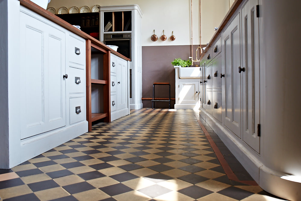 Original tiled floor with traditional painted kitchen cabinets