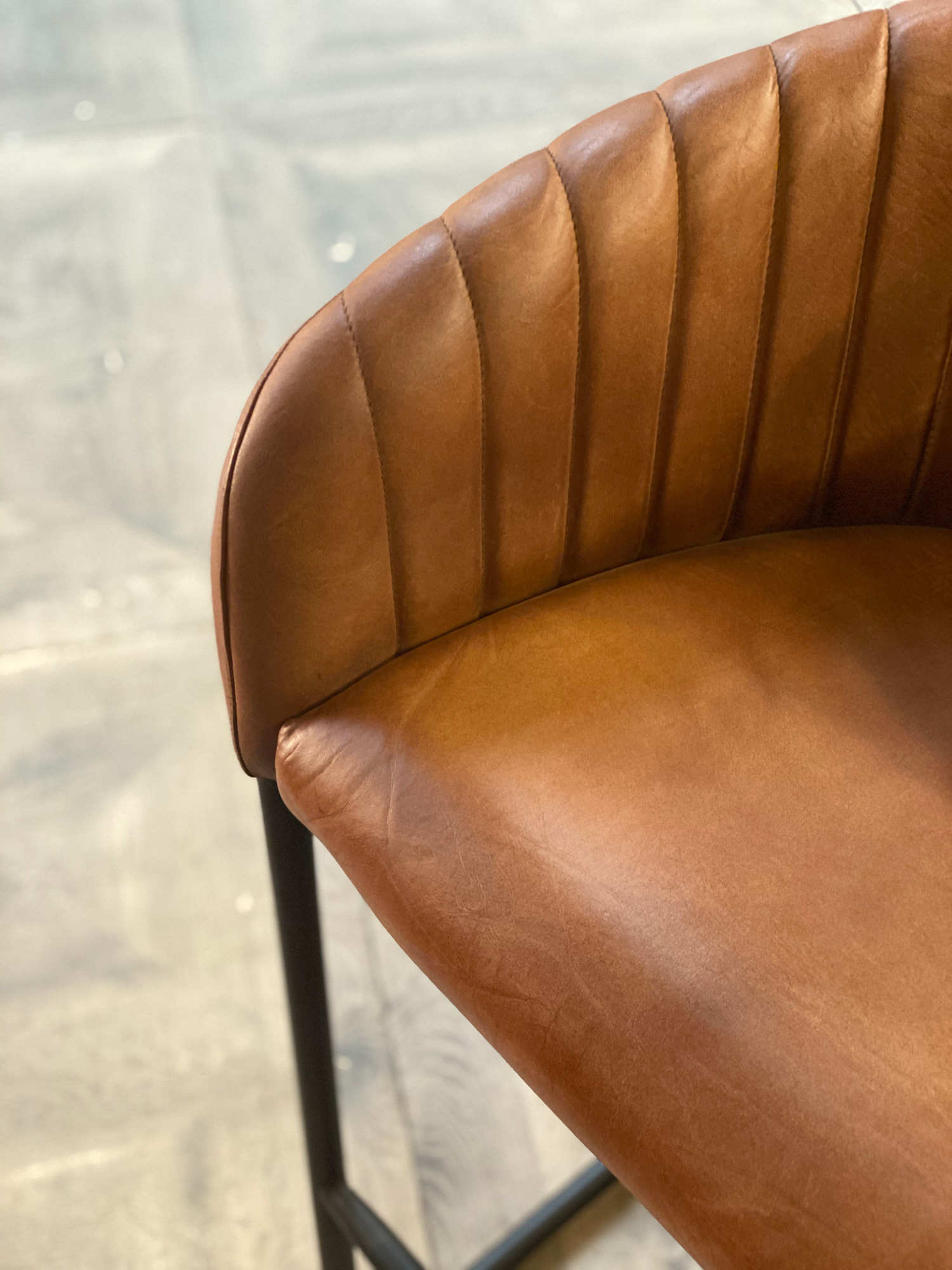Shell pattern on brown leather bar stool