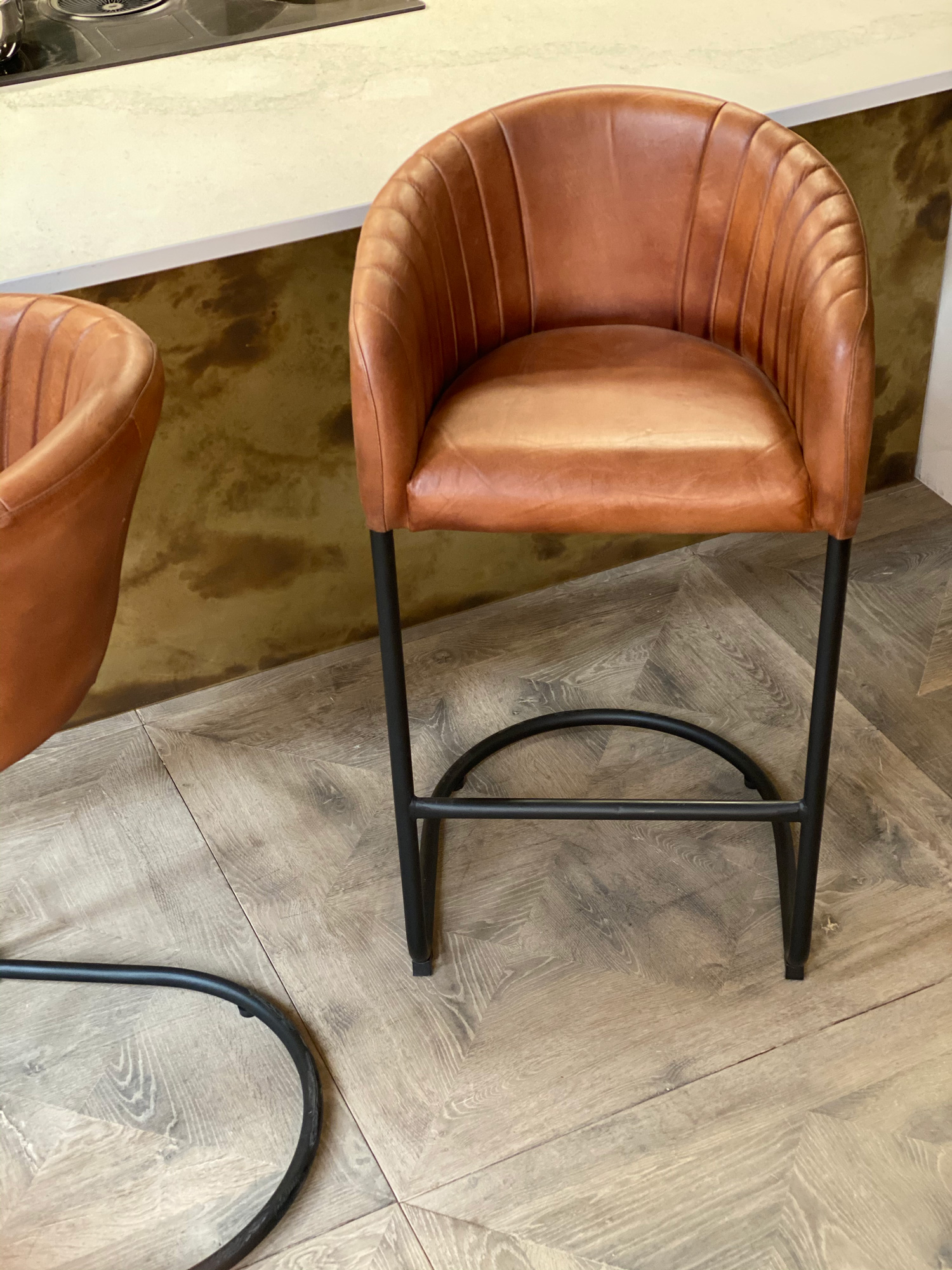 Brown leather and black metal tube base bar stool